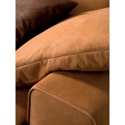 Padded sofa with reclining headrest - One